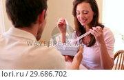 Купить «Woman opening a present from her boyfriend», видеоролик № 29686702, снято 12 декабря 2013 г. (c) Wavebreak Media / Фотобанк Лори