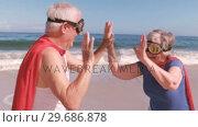 Купить «Fancy-dress mature couple clapping hands each other », видеоролик № 29686878, снято 12 ноября 2015 г. (c) Wavebreak Media / Фотобанк Лори