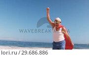 Купить «Fancy-dress mature man raising arms and running», видеоролик № 29686886, снято 12 ноября 2015 г. (c) Wavebreak Media / Фотобанк Лори