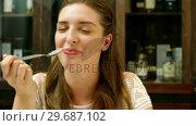 Купить «Happy woman tasting desert», видеоролик № 29687102, снято 23 ноября 2015 г. (c) Wavebreak Media / Фотобанк Лори