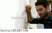 Купить «Man is standing with a sad expression on his face», видеоролик № 29687158, снято 16 декабря 2015 г. (c) Wavebreak Media / Фотобанк Лори