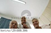 Senior man and woman interacting in old age home. Стоковое видео, агентство Wavebreak Media / Фотобанк Лори