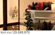 Купить «Christmas decoration with clothes hanging on hanger», видеоролик № 29688870, снято 31 августа 2016 г. (c) Wavebreak Media / Фотобанк Лори