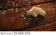 Купить «Close-up of three cookies on a plank», видеоролик № 29688910, снято 30 августа 2016 г. (c) Wavebreak Media / Фотобанк Лори