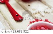 Купить «Spatula, dessert toppings, cookie cutter and various christmas accessories», видеоролик № 29688922, снято 30 августа 2016 г. (c) Wavebreak Media / Фотобанк Лори