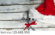 Купить «Cutlery tied up with ribbon», видеоролик № 29688950, снято 30 августа 2016 г. (c) Wavebreak Media / Фотобанк Лори