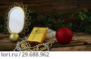 Купить «Christmas decoration and ornaments on wooden plank», видеоролик № 29688962, снято 30 августа 2016 г. (c) Wavebreak Media / Фотобанк Лори