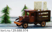 Купить «Toy tempo carrying christmas present on wooden plank», видеоролик № 29688974, снято 30 августа 2016 г. (c) Wavebreak Media / Фотобанк Лори