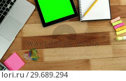 Купить «Laptop, digital tablet, diary and stationery», видеоролик № 29689294, снято 8 июня 2016 г. (c) Wavebreak Media / Фотобанк Лори