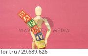 Купить «Figurine holding alphabet toy block», видеоролик № 29689626, снято 24 августа 2016 г. (c) Wavebreak Media / Фотобанк Лори