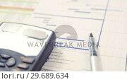 Купить «Calculator, document and graph», видеоролик № 29689634, снято 24 августа 2016 г. (c) Wavebreak Media / Фотобанк Лори