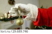 Купить «Santa claus holding christmas bauble ball», видеоролик № 29689746, снято 6 июня 2016 г. (c) Wavebreak Media / Фотобанк Лори