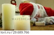 Купить «Santa claus sleeping at desk», видеоролик № 29689766, снято 6 июня 2016 г. (c) Wavebreak Media / Фотобанк Лори