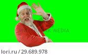 Купить «Portrait of happy santa claus singing song», видеоролик № 29689978, снято 7 сентября 2016 г. (c) Wavebreak Media / Фотобанк Лори