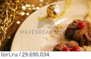 Купить «Mini chocolate bundt cakes with icing sugar», видеоролик № 29690034, снято 31 августа 2016 г. (c) Wavebreak Media / Фотобанк Лори