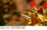 Купить «Gold christmas decoration», видеоролик № 29690042, снято 31 августа 2016 г. (c) Wavebreak Media / Фотобанк Лори
