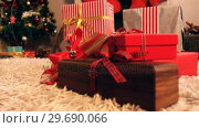Купить «Close-up of wrapped gift on fur carpet», видеоролик № 29690066, снято 31 августа 2016 г. (c) Wavebreak Media / Фотобанк Лори