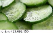 Купить «Close-up of slice cucumber», видеоролик № 29692150, снято 12 августа 2016 г. (c) Wavebreak Media / Фотобанк Лори