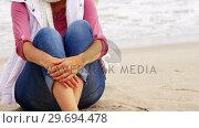 Купить «Thoughtful mature sitting on sand», видеоролик № 29694478, снято 29 сентября 2016 г. (c) Wavebreak Media / Фотобанк Лори