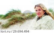 Купить «Happy mature woman in shawl feeling cold», видеоролик № 29694494, снято 29 сентября 2016 г. (c) Wavebreak Media / Фотобанк Лори
