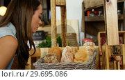 Купить «Woman purchasing bread at bakery section», видеоролик № 29695086, снято 4 октября 2016 г. (c) Wavebreak Media / Фотобанк Лори