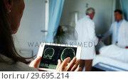 Купить «Doctor examining report on digital tablet», видеоролик № 29695214, снято 6 ноября 2016 г. (c) Wavebreak Media / Фотобанк Лори