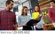 Купить «Business executives discussing over file in meeting», видеоролик № 29695602, снято 15 октября 2016 г. (c) Wavebreak Media / Фотобанк Лори