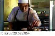 Купить «Chef working in a restaurant», видеоролик № 29695854, снято 14 ноября 2016 г. (c) Wavebreak Media / Фотобанк Лори