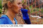 Купить «Pensive woman standing in the boot camp», видеоролик № 29696190, снято 24 ноября 2016 г. (c) Wavebreak Media / Фотобанк Лори