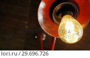 Купить «Illuminated electric bulb », видеоролик № 29696726, снято 15 ноября 2016 г. (c) Wavebreak Media / Фотобанк Лори