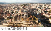 Купить «Aerial view of Manresa town with Basilica de Santa Maria, Catalonia, Spain», видеоролик № 29696918, снято 24 декабря 2018 г. (c) Яков Филимонов / Фотобанк Лори