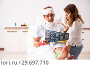 Купить «Loving wife looking after injured husband», фото № 29697710, снято 2 октября 2018 г. (c) Elnur / Фотобанк Лори