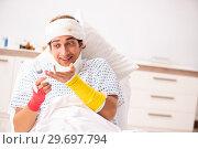 Купить «Young doctor examining injured patient», фото № 29697794, снято 2 октября 2018 г. (c) Elnur / Фотобанк Лори