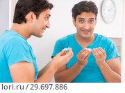 Купить «Man trying contact lenses at home», фото № 29697886, снято 6 августа 2018 г. (c) Elnur / Фотобанк Лори