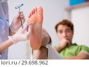 Купить «Podiatrist treating feet during procedure», фото № 29698962, снято 29 августа 2018 г. (c) Elnur / Фотобанк Лори