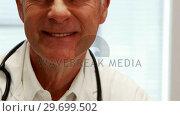 Купить «Portrait of doctor smiling at camera», видеоролик № 29699502, снято 5 ноября 2016 г. (c) Wavebreak Media / Фотобанк Лори