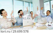 Купить «Business colleagues throwing crumpled paper in air», видеоролик № 29699578, снято 26 ноября 2016 г. (c) Wavebreak Media / Фотобанк Лори