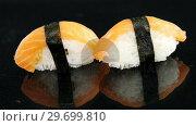Купить «Nigiri sushi wrapped in nori seaweed», видеоролик № 29699810, снято 8 декабря 2016 г. (c) Wavebreak Media / Фотобанк Лори
