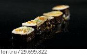 Купить «Maki sushi roll served on black stone plate», видеоролик № 29699822, снято 8 декабря 2016 г. (c) Wavebreak Media / Фотобанк Лори