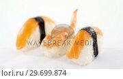 Купить «Sushi roll and shrimp on white background», видеоролик № 29699874, снято 8 декабря 2016 г. (c) Wavebreak Media / Фотобанк Лори