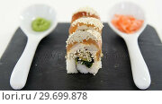 Nigiri sushi roll served on black stone slate. Стоковое видео, агентство Wavebreak Media / Фотобанк Лори