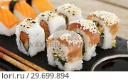 Купить «Set of assorted sushi served on black stone slate», видеоролик № 29699894, снято 8 декабря 2016 г. (c) Wavebreak Media / Фотобанк Лори