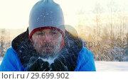 Купить «Man blowing snow during winter season 4k», видеоролик № 29699902, снято 14 декабря 2017 г. (c) Wavebreak Media / Фотобанк Лори
