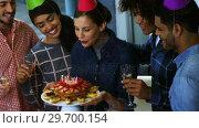 Купить «Happy executives celebrating their colleagues birthday», видеоролик № 29700154, снято 23 ноября 2016 г. (c) Wavebreak Media / Фотобанк Лори