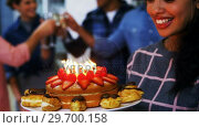 Купить «Happy executives celebrating their colleagues birthday», видеоролик № 29700158, снято 23 ноября 2016 г. (c) Wavebreak Media / Фотобанк Лори
