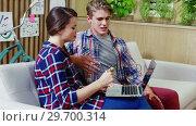 Купить «Executives doing online shopping on laptop», видеоролик № 29700314, снято 27 ноября 2016 г. (c) Wavebreak Media / Фотобанк Лори