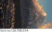 Купить «Петропавловск-Камчатский и вулкан. Вертикальный time lapse для социальных сетей», видеоролик № 29700514, снято 23 мая 2019 г. (c) А. А. Пирагис / Фотобанк Лори