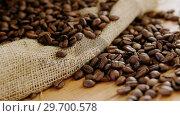 Купить «Roasted coffee beans on sack textile», видеоролик № 29700578, снято 6 октября 2016 г. (c) Wavebreak Media / Фотобанк Лори