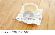 Купить «Close-up of white coffee cup with creamy froth», видеоролик № 29700594, снято 6 октября 2016 г. (c) Wavebreak Media / Фотобанк Лори