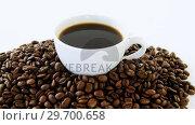 Купить «Cup of black coffee with roasted coffee beans», видеоролик № 29700658, снято 6 октября 2016 г. (c) Wavebreak Media / Фотобанк Лори